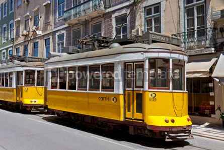 Transportation: Typical yellow trams on the street of Lisbon Portugal #07578