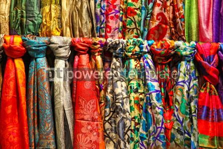 Arts & Entertainment: Rows of colourful silk scarfs hanging at a market stall in Istan #07585