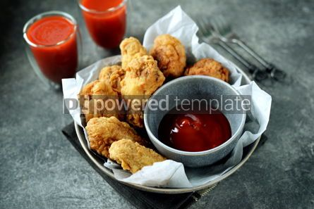 Food & Drink: Delicious homemade deep fried breaded chicken wings with tomato sauce on a gray background.  #07594