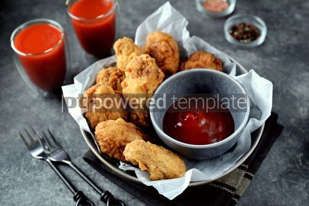 Food & Drink: Delicious homemade deep fried breaded chicken wings with tomato sauce on a gray background.  #07596