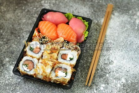 Food & Drink: Sushi roll with salmon soft cheese and tuna. Sushi delivery to home.  #07613