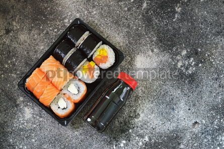Food & Drink: Sushi roll with salmon soft cheese and tuna. Sushi delivery to home. Healthy food. Top view.  #07616