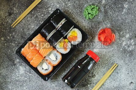 Food & Drink: Sushi roll with salmon soft cheese and tuna. Sushi delivery to home. Healthy food. Top view.  #07617