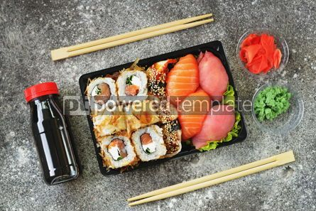 Food & Drink: Sushi roll with salmon soft cheese and tuna. Sushi delivery to home. Healthy food. Top view.  #07618