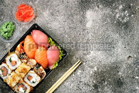 Food & Drink: Sushi roll with salmon soft cheese and tuna. Sushi delivery to home. Healthy food. Top view.  #07619