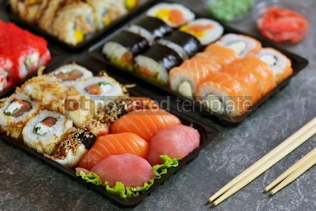 Food & Drink: Sushi roll with salmon soft cheese and tuna. Sushi delivery to home. Healthy food.  #07624