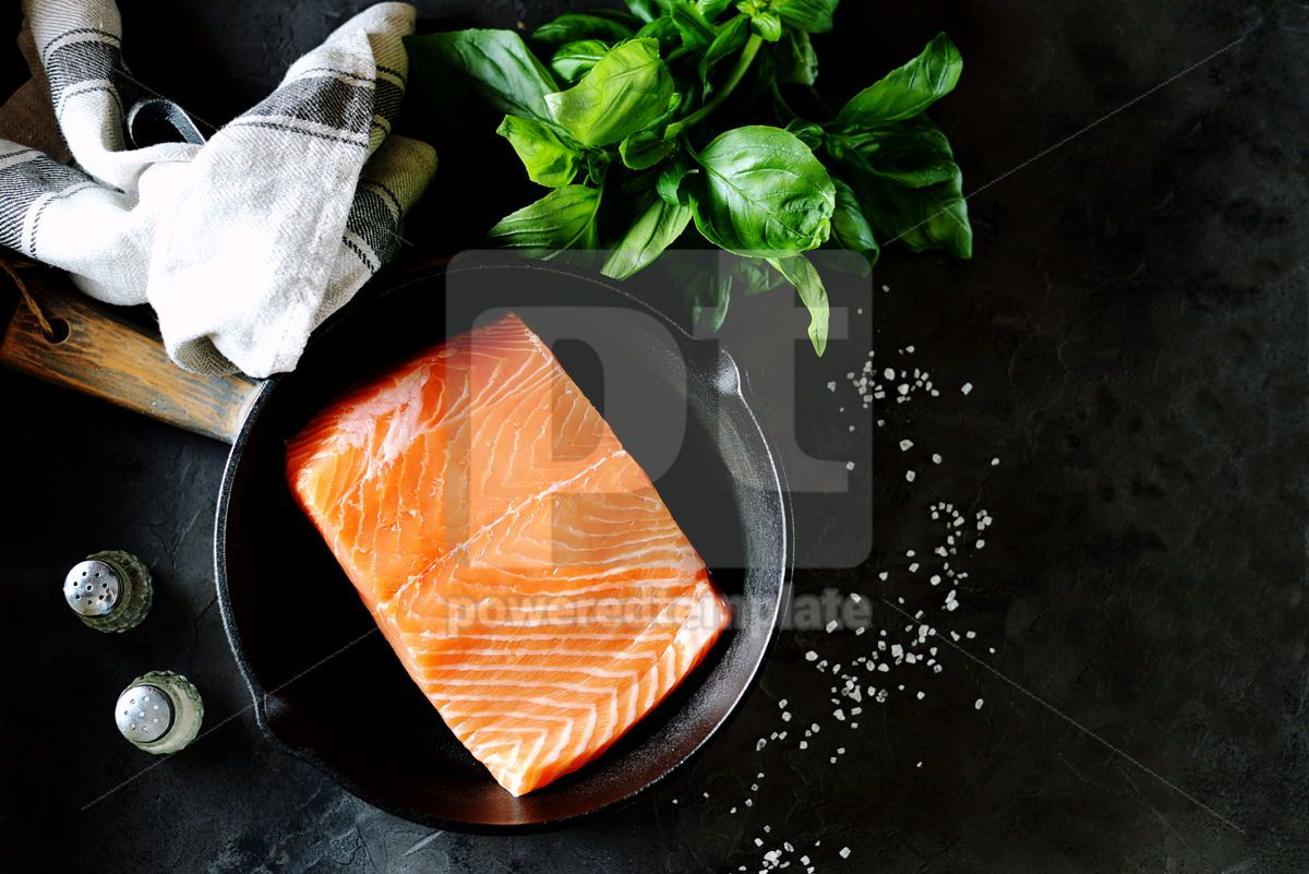 Fresh raw uncooked salmon in a cast iron pan on a black background. Healthy food. , 07630, Food & Drink — PoweredTemplate.com