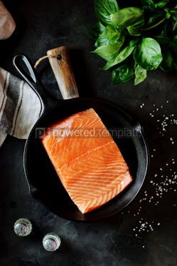 Food & Drink: Fresh raw uncooked salmon in a cast iron pan on a black background. Healthy food.  #07631