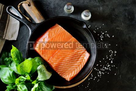 Food & Drink: Fresh raw uncooked salmon in a cast iron pan on a black background. Healthy food.  #07632