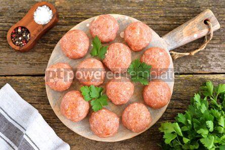 Food & Drink: Raw meatballs on a wooden board #07635