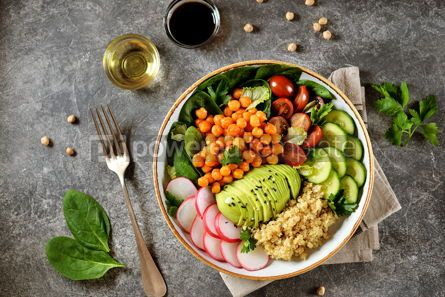 Food & Drink: Healthy vegetarian salad with chickpeas quinoa cherry tomatoes cucumber radish #07643