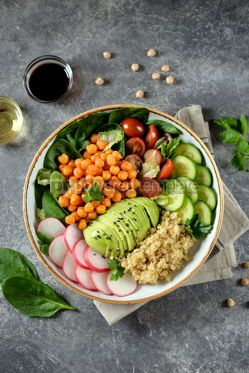 Food & Drink: Healthy vegetarian salad with chickpeas quinoa cherry tomatoes cucumber radish #07644