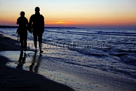 Nature: Couple of people enjoying a beach walk at sunset  #08346