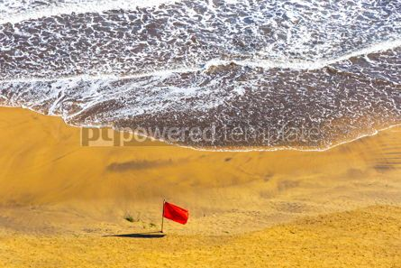 Nature: Red flag on the beach during the storm #09334
