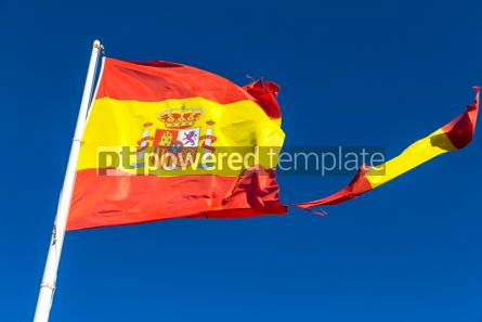 Education: Torn Spanish flag waving on the wind #09770
