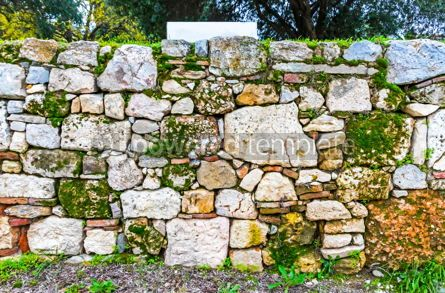 Architecture : Ancient wall made of natural rocks with plants between blocks #13373