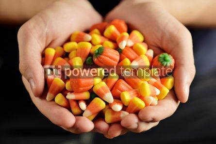 Food & Drink: Candy corn and pumpkin in male hands Halloween party #13404