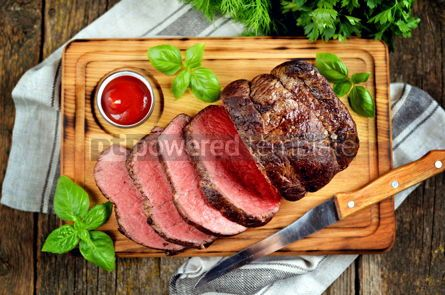 Food & Drink: Roast beef medium rare on a wooden cutting board with tomato sauce #13542