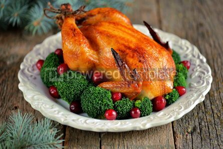 Food & Drink: Grilled chicken with boiled broccoli and cranberries on a wooden background Christmas background #13593