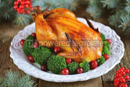 Food & Drink: Grilled chicken with boiled broccoli and cranberries on a wooden background Christmas background #13594