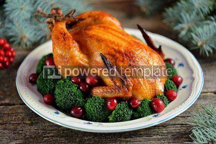 Food & Drink: Grilled chicken with boiled broccoli and cranberries on a wooden background Christmas background #13595