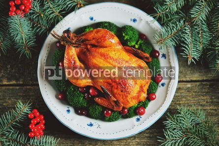 Food & Drink: Grilled chicken with boiled broccoli and cranberries on a wooden background Christmas background #13596