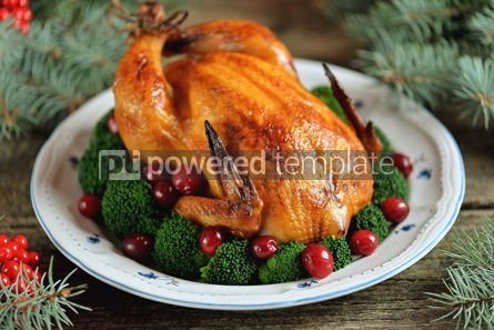 Food & Drink: Grilled chicken with boiled broccoli and cranberries on a wooden background Christmas background #13597