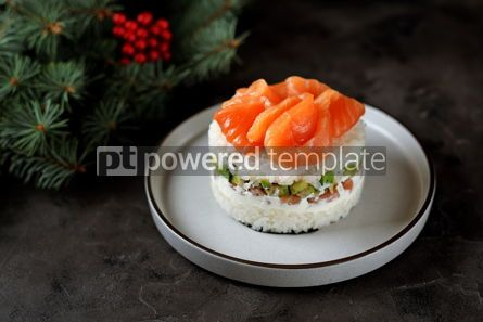 Food & Drink: Homemade sushi cake with lightly salted salmon avocado soft cheese and seaweed Christmas backgrou #13631