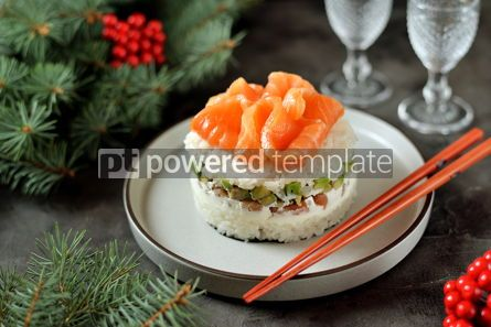 Food & Drink: Homemade sushi cake with lightly salted salmon avocado soft cheese and seaweed Christmas backgrou #13632