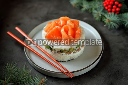 Food & Drink: Homemade sushi cake with lightly salted salmon avocado soft cheese and seaweed Christmas backgrou #13633