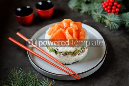 Food & Drink: Homemade sushi cake with lightly salted salmon avocado soft cheese and seaweed Christmas backgrou #13634