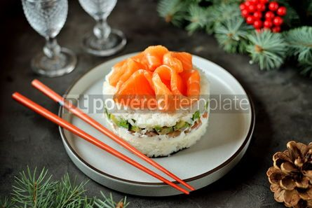 Food & Drink: Homemade sushi cake with lightly salted salmon avocado soft cheese and seaweed Christmas backgrou #13635
