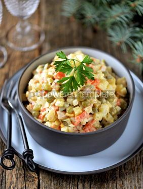Food & Drink: Traditional Russian salad Olivier on an old wooden background Russian kitchen Rustic style #13638
