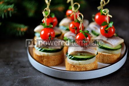 Food & Drink: Canape with salted herring cucumber boiled potatoes and cherry tomato on rye croutons Christmas b #13664