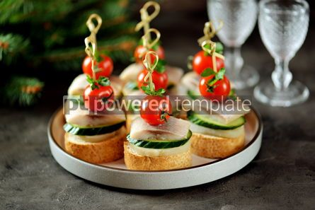 Food & Drink: Canape with salted herring cucumber boiled potatoes and cherry tomato on rye croutons Christmas b #13665