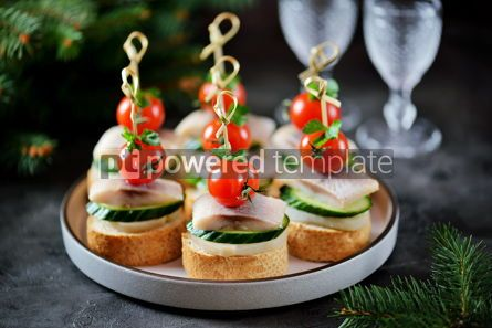 Food & Drink: Canape with salted herring cucumber boiled potatoes and cherry tomato on rye croutons Christmas b #13668