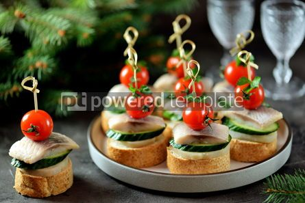 Food & Drink: Canape with salted herring cucumber boiled potatoes and cherry tomato on rye croutons Christmas b #13669