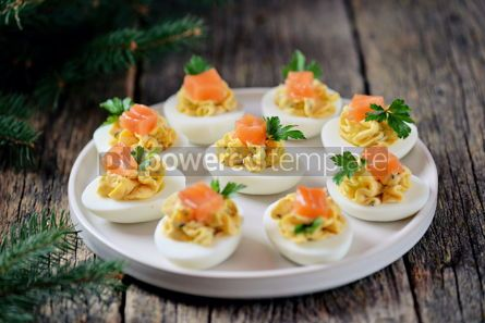 Food & Drink: Stuffed chicken eggs with soft cheese capers and salted salmon Christmas background #13670