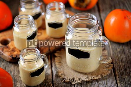 Food & Drink: Healthy persimmon smoothie with banana and yogurt on wooden background #13679
