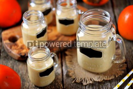 Food & Drink: Healthy persimmon smoothie with banana and yogurt on wooden background #13680