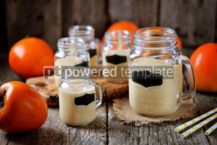 Food & Drink: Healthy persimmon smoothie with banana and yogurt on wooden background #13682