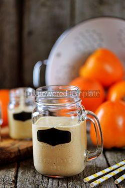 Food & Drink: Healthy persimmon smoothie with banana and yogurt on wooden background #13683