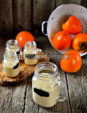 Food & Drink: Healthy persimmon smoothie with banana and yogurt on wooden background #13684