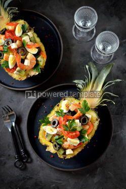 Food & Drink: Festive salad of shrimp kiwi olives soft cheese quail eggs cherry tomato in pineapple plates C #13707