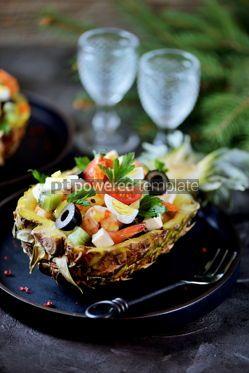 Food & Drink: Festive salad of shrimp kiwi olives soft cheese quail eggs cherry tomato in pineapple plates C #13709