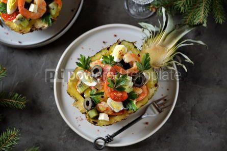 Food & Drink: Festive salad of shrimp kiwi olives soft cheese quail eggs cherry tomato in pineapple plates C #13711