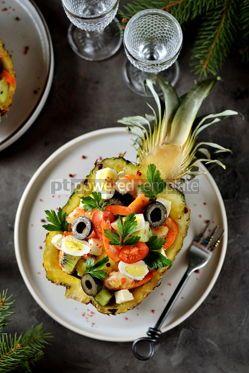 Food & Drink: Festive salad of shrimp kiwi olives soft cheese quail eggs cherry tomato in pineapple plates C #13712