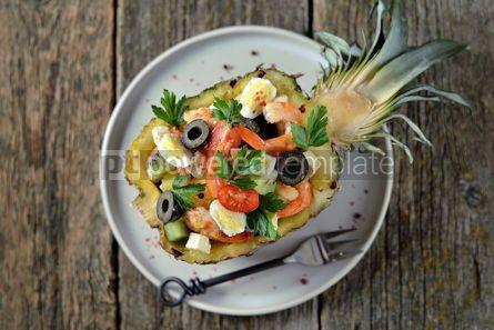 Food & Drink: Festive salad of shrimp kiwi olives soft cheese quail eggs cherry tomato in pineapple plates C #13713