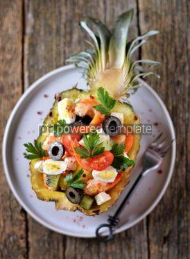 Food & Drink: Festive salad of shrimp kiwi olives soft cheese quail eggs cherry tomato in pineapple plates C #13714
