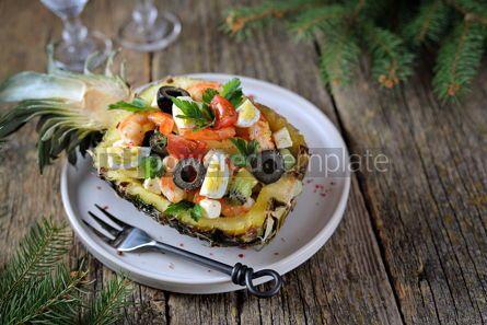 Food & Drink: Festive salad of shrimp kiwi olives soft cheese quail eggs cherry tomato in pineapple plates C #13716